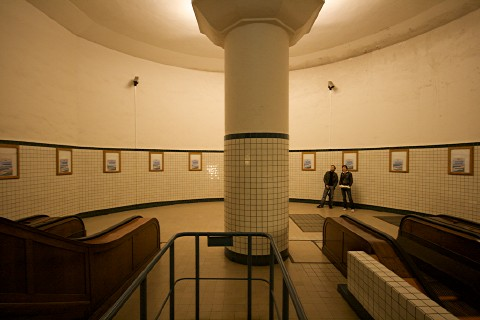 photograph of a stairwell platform leading down into the tunnel