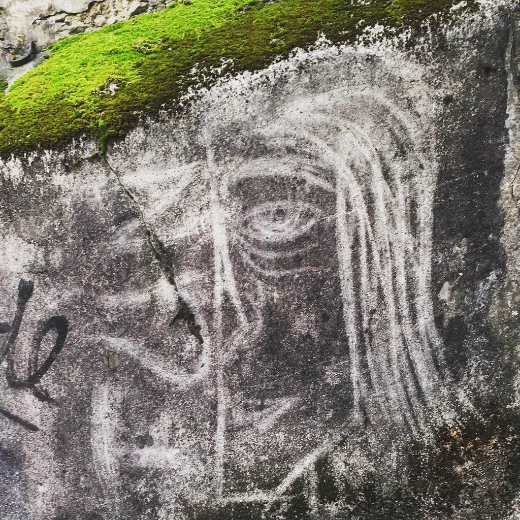 face at the wall